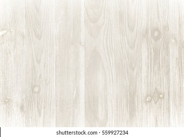 Old weathered wood surface with long boards lined up. Wooden planks on a wall or floor with grain and texture. Light neutral tones.