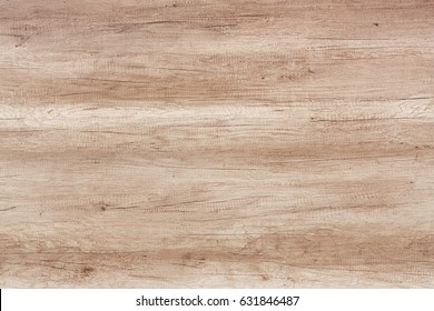 Old weathered wood surface with long boards lined up. Wooden planks on a wall or floor with grain and texture. Light neutral tones. Washed wood texture.