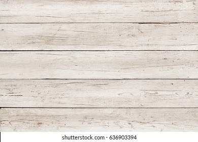 Old weathered wood surface with long boards lined up. Wooden planks on a wall or floor with grain and texture. Light neutral tones. Washed wood texture