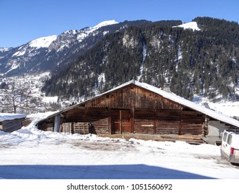 Old weathered wooden barn and stable, in the alpine village of Chatel, France