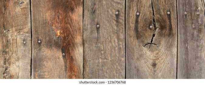 old, weathered wooden boards with beautiful patina as a background for the decorative design. The bars are horizontal.