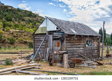 Old weathered wooden building on a farm in Patagonia, Chile