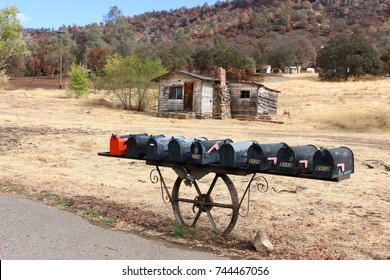 Old weathered wooden cabin, with unusual mail boxes, Mariposa county, California.