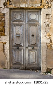Old weathered wooden door with sunbeam on it