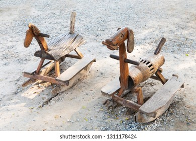 Old and weathered wooden rocking horse in park