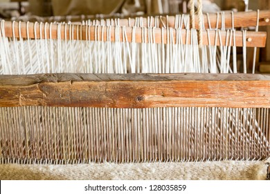 Old weaving loom made from timber making cloth in La Purisima mission California