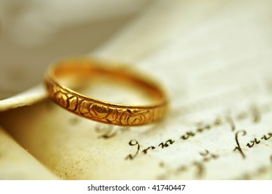 Old wedding ring on an old diary and vintage photo