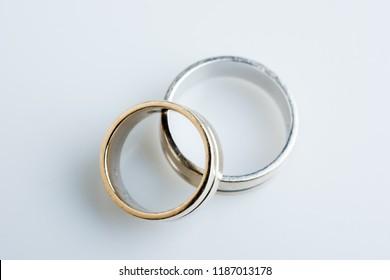Old wedding ring on white background .