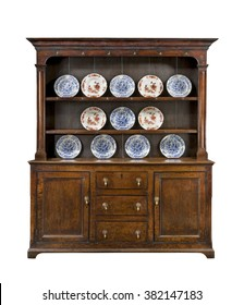 Old Welsh dresser cupboard sideboard in oak with plates isolated on white with clipping path