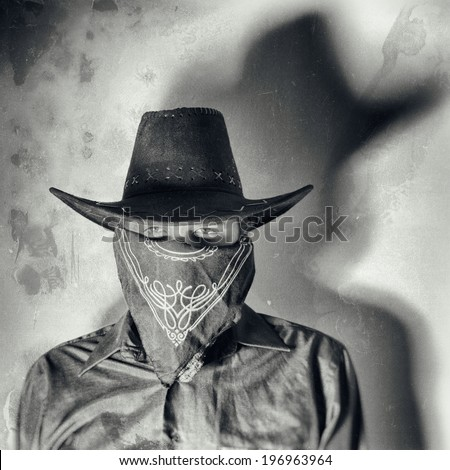 1a807efb32d48 Old West Bandit. Old west bandit outlaw with covered face and cowboy hat