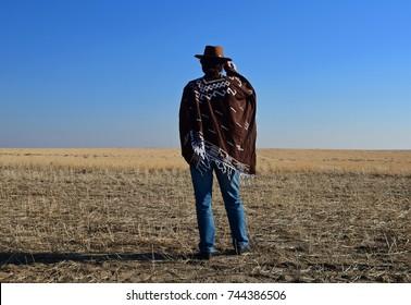 Old west cowboy on prairie