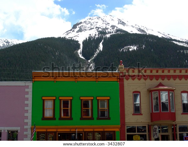 Old West hotel and bordello construction with Rocky Mountain backdrop
