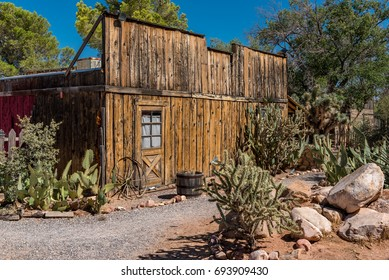 Old western building with wagon wheel and desert cacti
