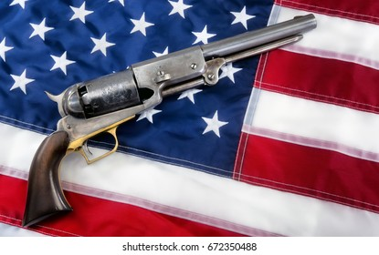 Old western cowboy pistol on flag with room for your type.