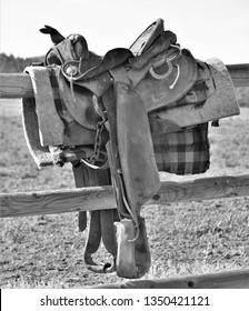 Old Western Saddle on a Fence