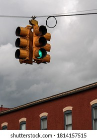 Old Western storefront with a stoplight against a cloudy sky