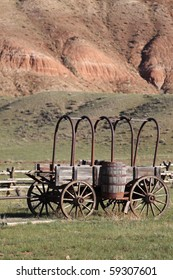 Old western wagons against a Wyoming background