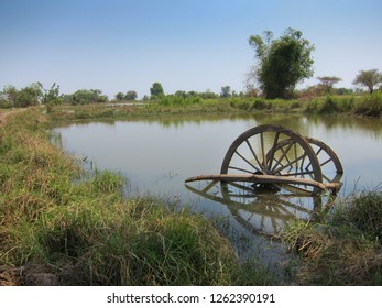 Old wheel on farmland in Battambang, Cambodia