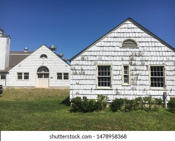 Old white barn buildings at Caumsett State Park in the village of Lloyd Neck in the town of Huntington, Long Island, NY.