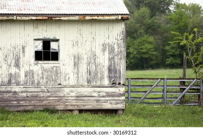 old white barn with window and gate