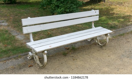 Old white bench in the park