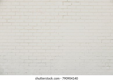 Old white brick wall background texture close up
