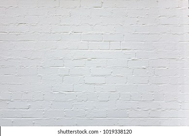 Old White Brick Wall With Grungy Plaster Layer Horizontal Background. Abstract Whitewashed Brickwork Vintage Texture. Gray Shabby Bricklaiing Backdrop.