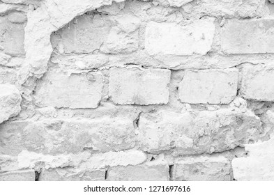old white brick wall texture for background. Weathered white textured pattern background with copy space for text.