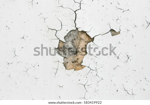 old white cracked paint on boards