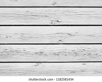 Old white cracked wood planks.