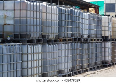 old white IBC containers on, Chemical storage container.