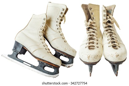 Old white ice skating shoes and blades isolated on white background - stock image. Vintage ice skates. File contains a clipping path.