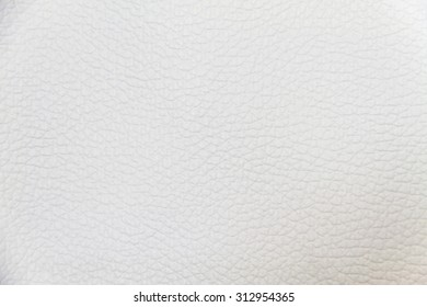 old white leatherette texture as background