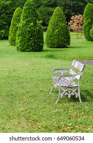 old white metal chairs in the Garden symbolize relaxation after a day of hard work