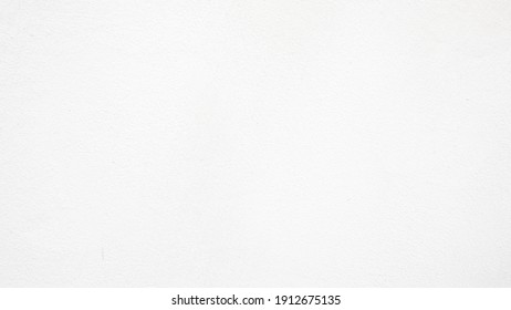 Old white mortar wall background. Stone plastered stucco wall. Color gray grunge cement backgrounds. Raw concrete texture. top view.