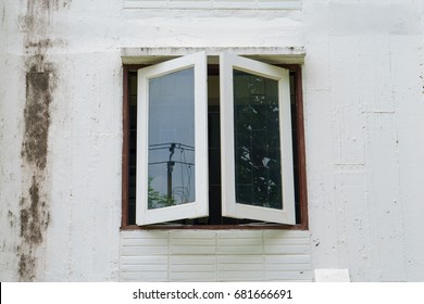 old white opened window on old ancient building