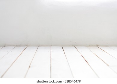 Old white painted floorboards with a shallow depth of field. Place to copy and paste various objects.
