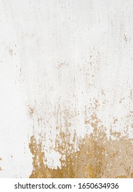 Old white painted wall with aged structure plaster