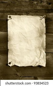 old white paper clipped on boards background vertical