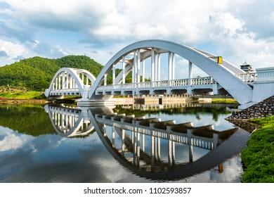 Old white railway bridge constructed at Lamphun, Thailand.