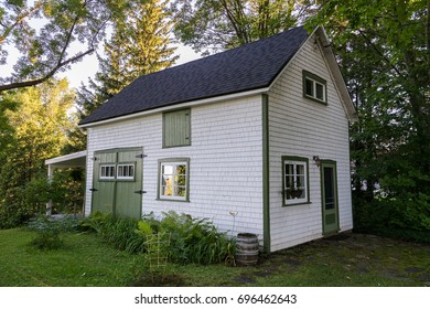 Old white shingled stable turned into country guest house in Ste. Petronille, Island of Orleans, Quebec, Canada