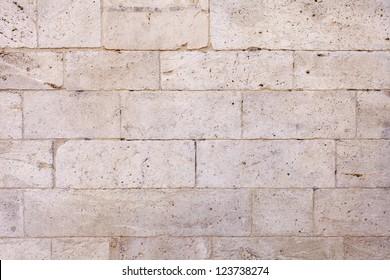 Old White Stone Blocks Wall Background. Macro shot.