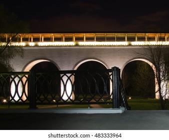 old white stone bridge in park at night