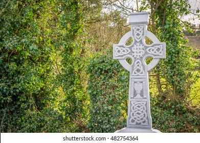 Old white stone celtic cross. Background with copy space for text.