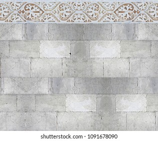 Old white stone wall with molding stone eaves with foliage and plants - image with copy space