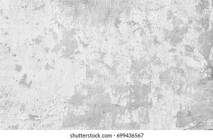 Old white stucco wall background. White painted cement wall texture