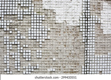 Old white tile on the concrete wall