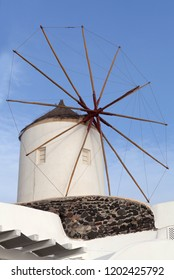 Old white traditional windmill in Oia village on Santorini Island, Cyclades, Greece
