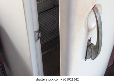 Old white vintage refrigerator door handle with copy space for text. Refrigerator handle concept.