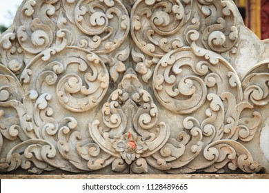 Old white wall design bas-relief with stucco wild flower vine element. Beautiful traditional Thai style stucco wild flower vine patterned for decorative on wall background.